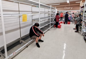 People wait for a delivery of toilet paper, paper towel and pasta at a Sydney supermarket during the Covid-induced lockdown.