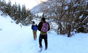 Migrants attempting to cross into France return to Bardonecchia after being turned back by heavy snow.