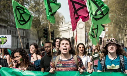 Extinction Rebellion protesters heading to Parliament Square in London on 18 April.