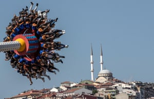 People enjoy a fun fair during the Eid al-Fitr festival in Istanbul