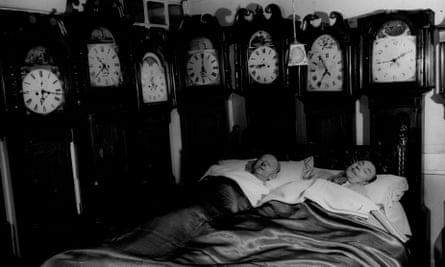 Mr and Mrs Charles Bromley of Belper, Derbyshire, at home with part of their collection of grandfather clocks, circa 1955.
