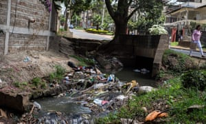 River clogged with plastic bags and rubbish