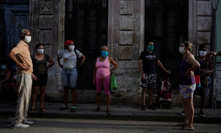 People queue to buy food amid concerns about the spread of the coronavirus outbreak, in downtown Havana last month.