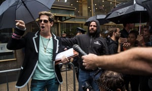 Milo Yiannopoulos (left) announces his lawsuit against Simon & Schuster outside the company's New York headquarters.