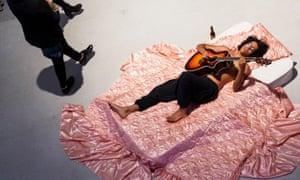 Visitors are serenaded at Ragnar Kjartansson's Barbican exhibition.