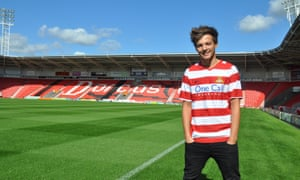 One Direction's Louis Tomlinson played reserve-team matches for Doncaster Rovers in 2013 in aid of a children's hospice