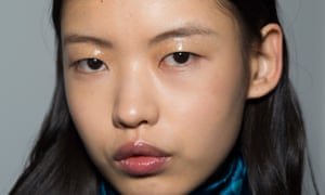 A model's face with eye and lip gloss