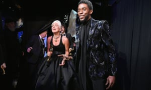 Lady Gaga poses with the Music (Original Song) award for Shallow from A Star Is Born backstage with presenter Chadwick Boseman during the 91st Annual Academy Awards at the Dolby Theatre in Hollywood on 24 February 2019.