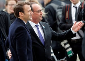 Macron and Hollande attend a ceremony at the Arc de Triomphe in Paris on Monday.