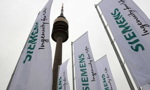 Siemens flags outside the Olympic hall in Munich