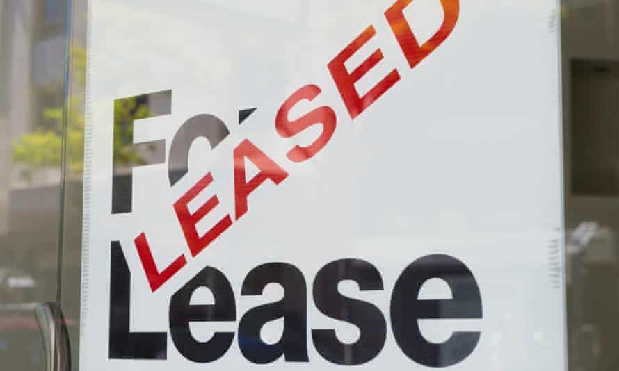 For lease and leased sign on display outside a building.