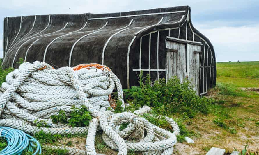 An upturned boat keel recycled as a fisherman's hut, Lindisfarne