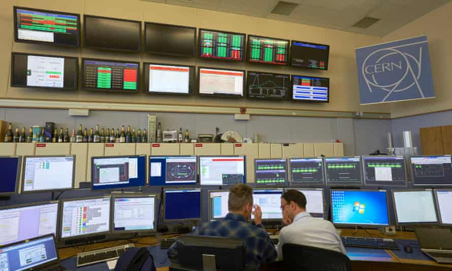 Technicians work in the Control Centre of the LHC