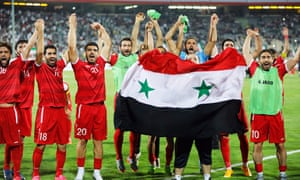 Syria's players celebrate after their 2-2 draw in Iran secured in the final minute which secured them a play-off place against Australia.