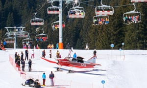 Emergency services gather around a plane which had earlier hit a woman skier while attempting take off at the French Alpine ski resort of Avoriaz.