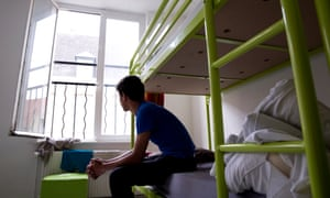 An unaccompanied child seeking asylum looks out from the dormitory in the home for young refugees run by Terre d'Asile.