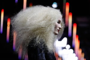 A model presents a creation for L'Oreal during a hair colouring show in Paris, France
