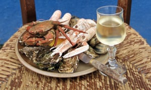 Seafood plate and white wine on wooden chair
