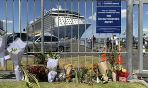 Flowers are laid on makeshift memorial is seen in front of cruise ship Ovation of the Seas, in Tauranga, New Zealand.