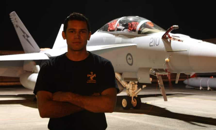 Michael Raymond was standing in front of an air force plane