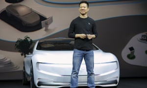 Jia Yueting, co-founder and head of LeEco, unveils an all-electric battery 'concept' car in Beijing on Wednesday. Links between LeEco, Atieva and Faraday Future are murky.