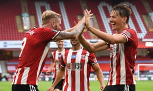 Oli McBurnie and Sander Berge celebrate after McBurnie scored the third goal for Sheffield United in their home win against Tottenham.