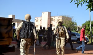 Malian army, French and UN troops take position outside the Radisson Blu hotel in Bamako.