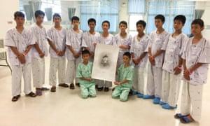 The Wild Boars football team and their coach at the Chiang Rai Prachanukroh hospital