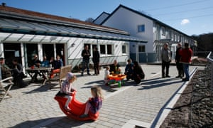 Residents outside the 'Common Room.' Lancaster Cohousing Project, Halton.
