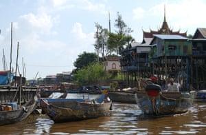 A boat chugs through Kampong Phluk commune, close to Tonlé Sap lake in Cambodia