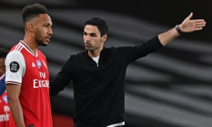 Arsenal's manager, Mikel Arteta, talks to Pierre-Emerick Aubameyang. The forward has scored five times in his past six games
