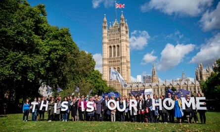 Protesters hold banners outside parliament calling for the rights of EU citizens living in the UK to be guaranteed