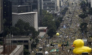 Demonstrators take part in a protest to demand the resignation of Brazilian president Dilma Rousseff.