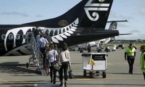 Passengers board an Air New Zealand flight at Christchurch Airport in Christchurch