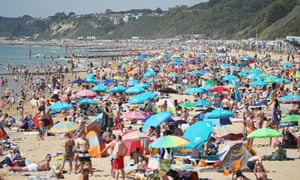 People enjoy the hot weather on Bournemouth beach.