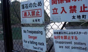 Warning signs near the cove in Taiji.