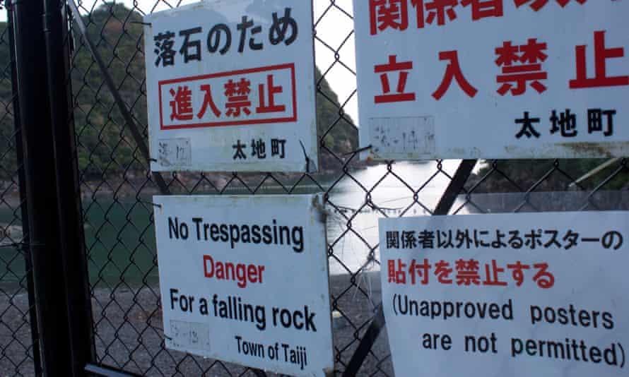 Warning signs near the cove in Taiji.