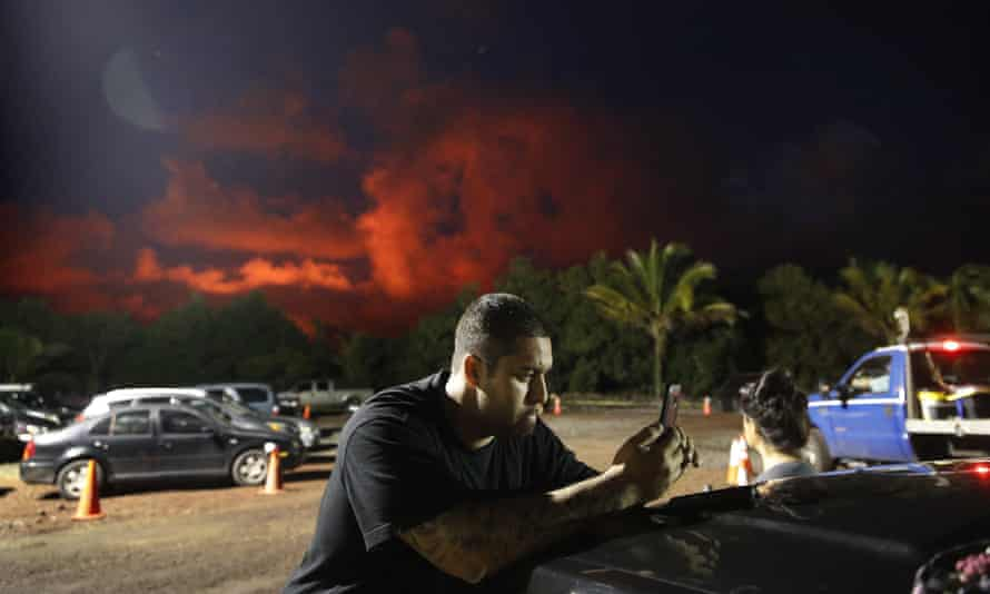 Evacuee Michael Hauanao, 32, at a makeshift donation center as clouds turn red from lava flow in the Leilani Estates subdivision.