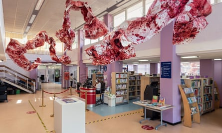 And They Still Seek the Traces of Blood by Imran Qureshi, a paper installation at Ealing Road Library
