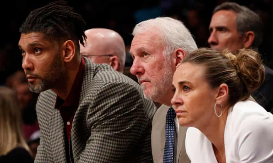 Becky Hammon (right) sits alongside fellow San Antonio Spurs assistant coach Tim Duncan (left) and head coach Gregg Popovich.