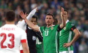 Corry Evans reacts after the referee, Ovidiu Hategan, gives Switzerland a penalty.