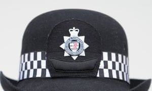 A female officer's hat with the Avon and Somerset police badge.
