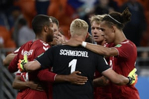 The Danish players celebrate at the final whistle.