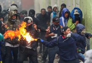 Quito, EcuadorA demonstrator throws a petrol bomb during protests against Ecuador's President Lenin Moreno's austerity measures.