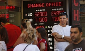 People line up at a currency exchange shop in Istanbul. Investors have been pulling out of Turkey's markets, sending its stock market and currency plunging.