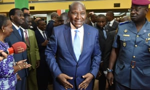 Former prime minister Daniel Kablan Duncan, centre, walks out the national assembly after being appointed Ivory Coast's vice-president