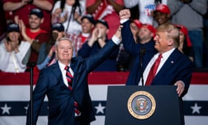 Donald Trump greets US Republican senator Lindsey Graham at a campaign rally in North Charleston on Friday.
