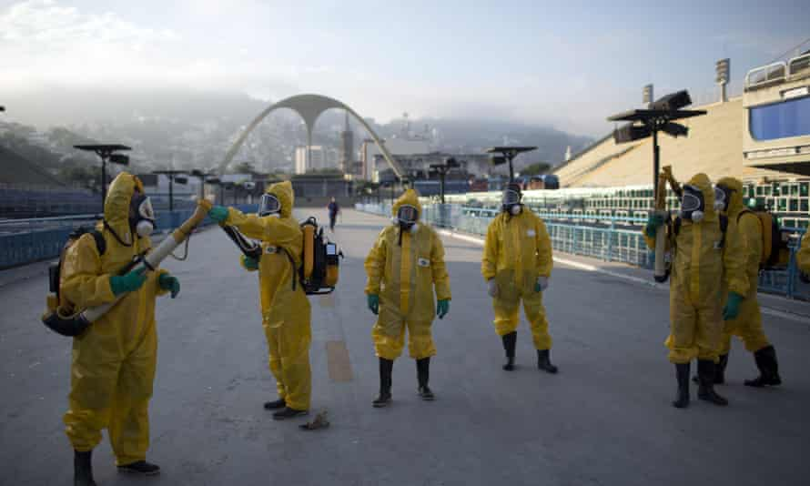 Health workers prepare to spray insecticide at the Sambadrome in Rio, which will be used for the archery competition