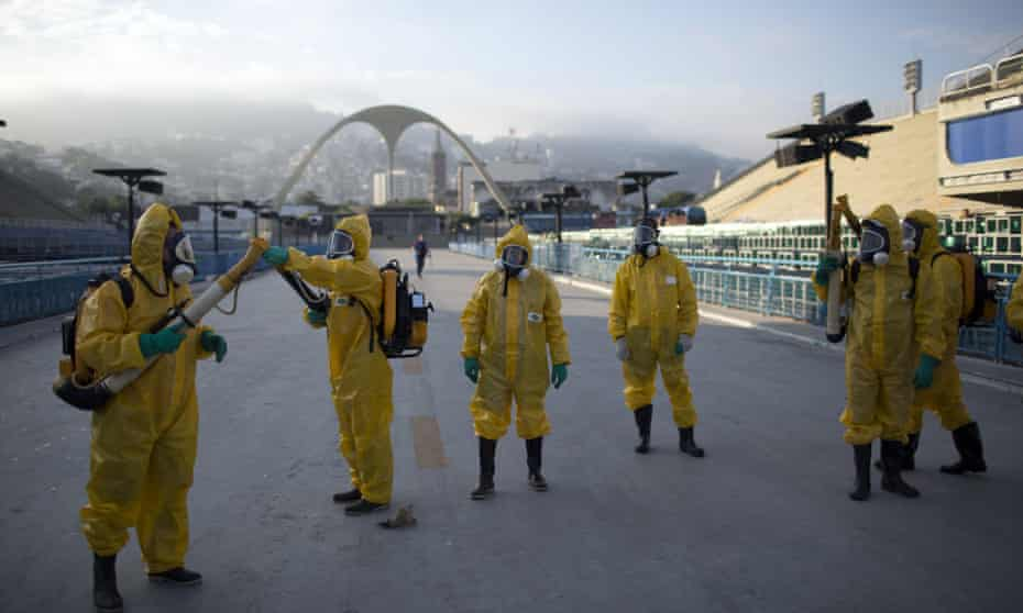 Health workers prepare to spray insecticide under the bleachers of the Sambadrome in Rio, which will be used in the 2016 Games.