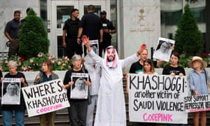 A demonstrator dressed as crown prince Mohammed bin Salman with blood on his hands protests outside the Saudi embassy in Washington DC, demanding justice for the missing Saudi journalist Jamal Khashoggi.